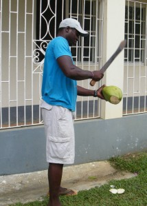 Dillon cutting open the coconuts with the machete!